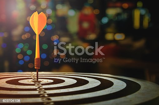 istock target dart with arrow over blurred Christmas background 623704108
