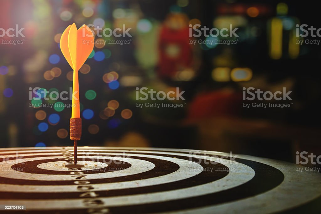 target dart with arrow over blurred Christmas background - Photo