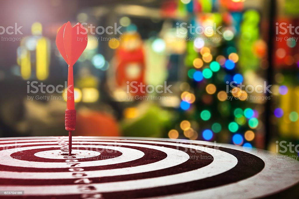 target dart with arrow over blurred Christmas background stock photo