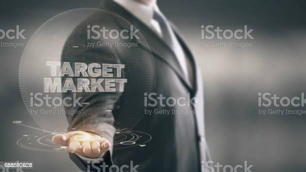 Target market businessman holding in hand new technologies picture id688592628?b=1&k=6&m=688592628&s=612x612&h=xxkdqafgd85njzjxm8slrxmonl217gyhbvbckajozcm=