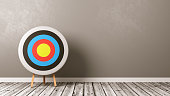 Colorful Arrow Target on Wooden Floor in a Gray Wall Room with Copy Space 3D Illustration