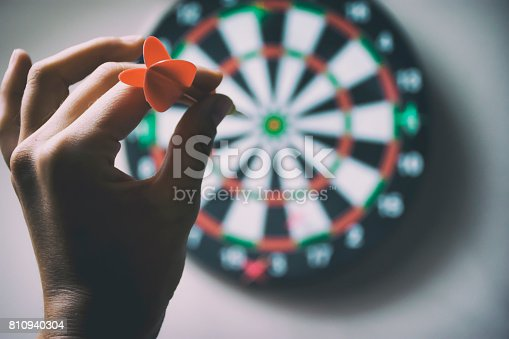 a hand holding arrow and pointing a darts
