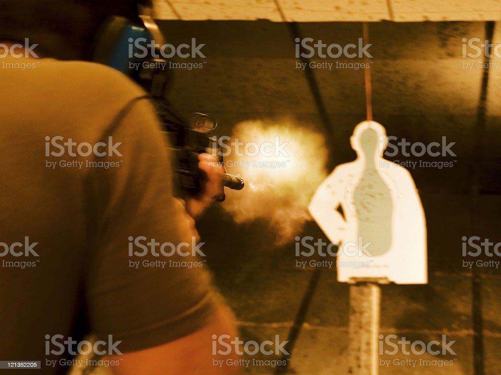 Target Practice: Man Shooting a Gun royalty-free stock photo