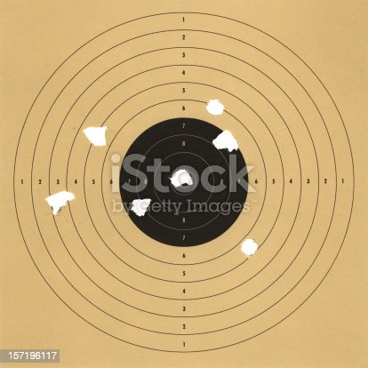 an old paper target with bullet holes