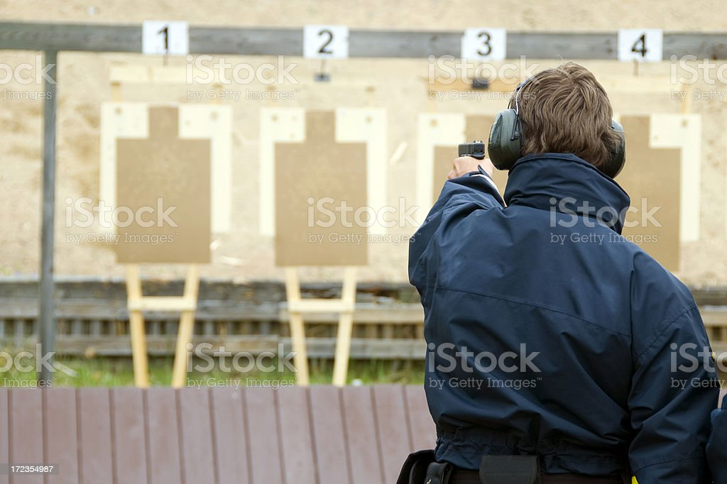 Target practicing with gun royalty-free stock photo