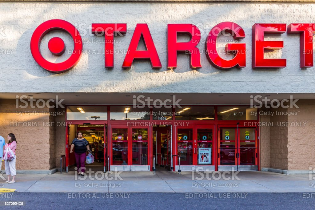 Target store entrance with woman walking out with sign stock photo