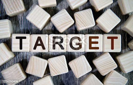 1131526784 istock photo Target - text concept seo on a wooden background surrounded by cubes 1224250409
