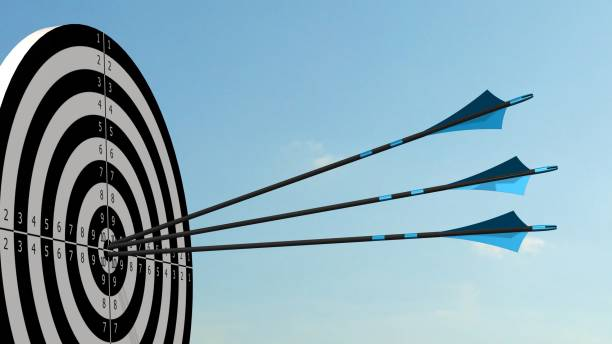 target with arrows - target with three bow arrows in the middle of the target - sports target stock photos and pictures