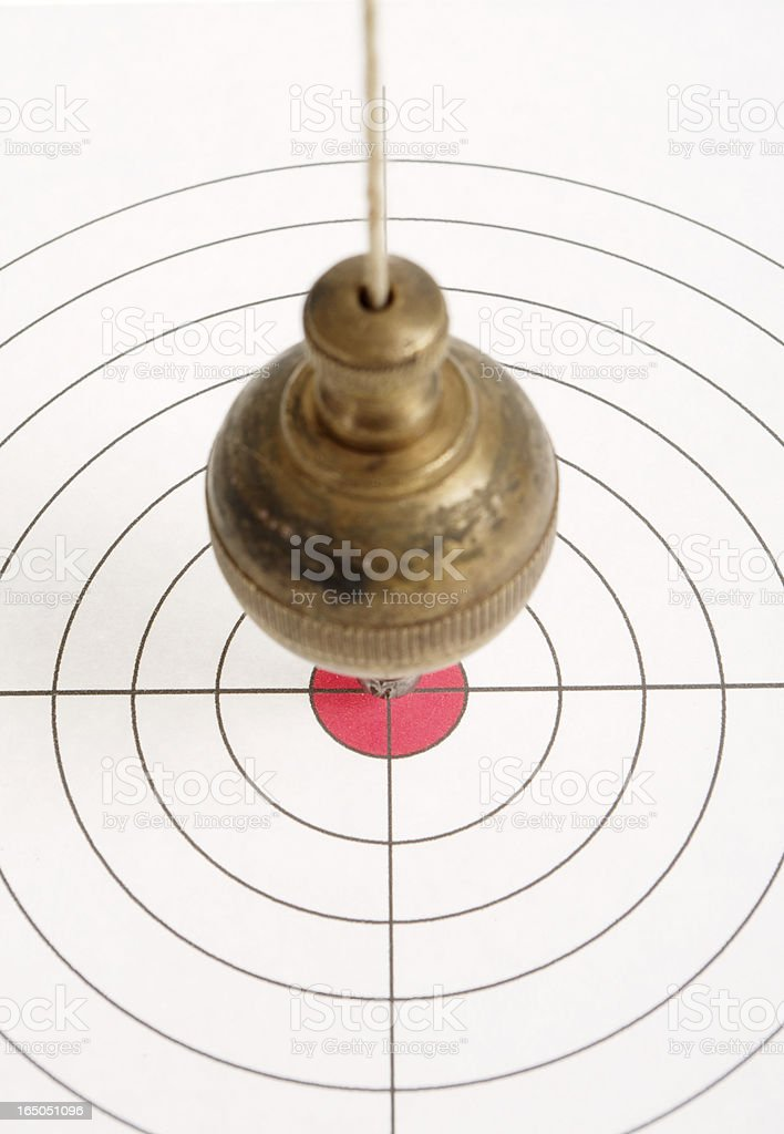Target With Old Brass Plumb Bob Pendulum Over Centre royalty-free stock photo