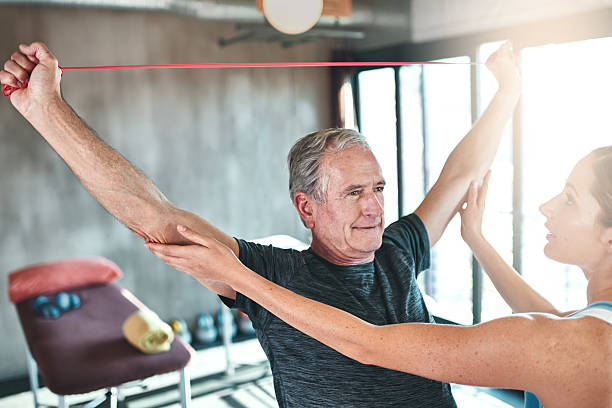 Targeting arm strength with resistance bands stock photo