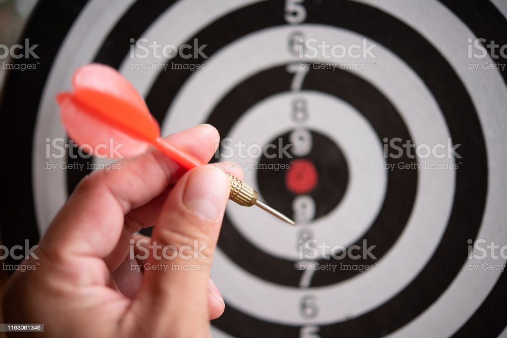 Targeting concept.Bullseye is a target of business. Dart is an...