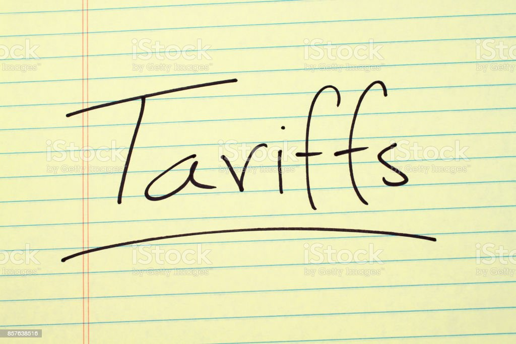 Tariff On A Yellow Legal Pad stock photo