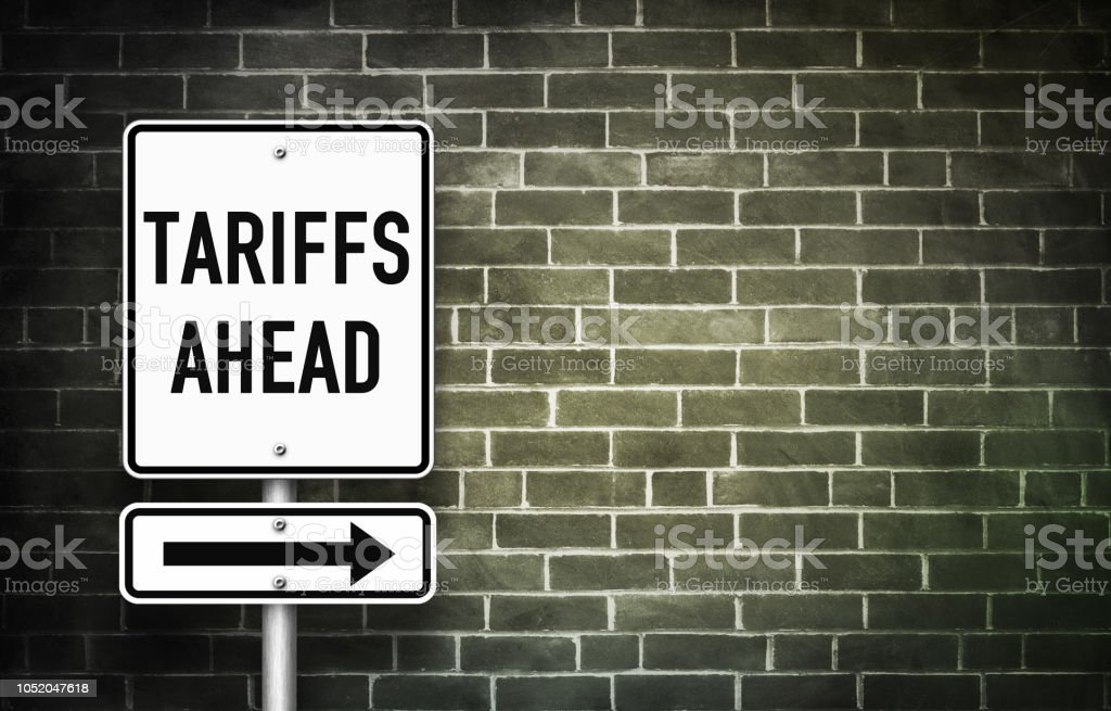 Tariffs ahead - traffic sign stock photo