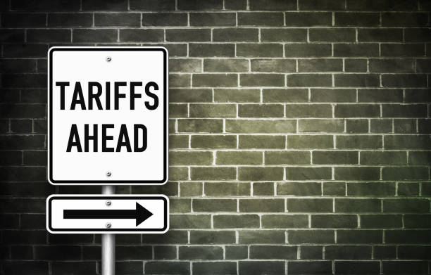 Tariffs ahead - traffic sign Tariffs ahead - traffic sign tariff stock pictures, royalty-free photos & images