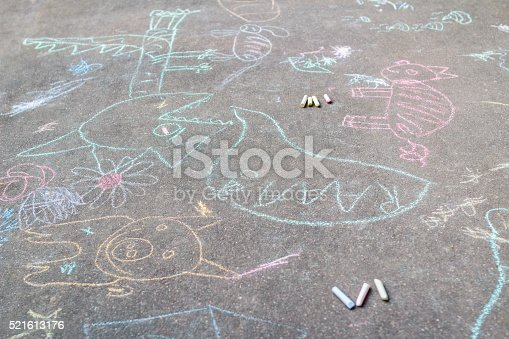 istock Tarmac covering with sidewalk chalking drawings 521613176