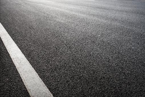 Black tarmac road texture