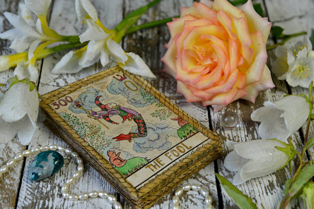 Tarot cards and flowers on witch wooden altar. stock photo