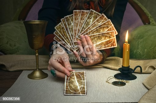 istock Tarot cards. Future reading concept. Fortune teller desk table. 930382356