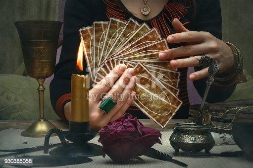 istock Tarot cards on fortune teller desk table. Future reading concept. 930385058