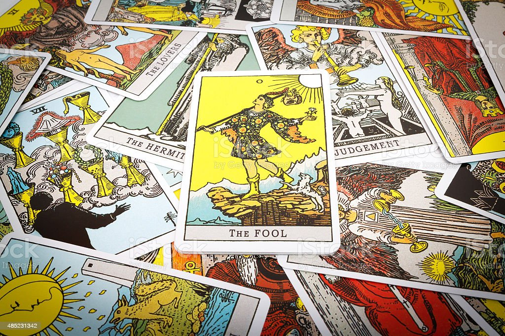 Tarot cards Tarot Tarot cards Tarot, the fool card in the foreground. Tarot Cards Stock Photo