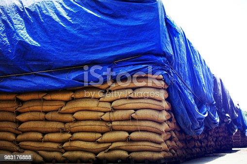 istock Tarpaulin on grain stack 983176888