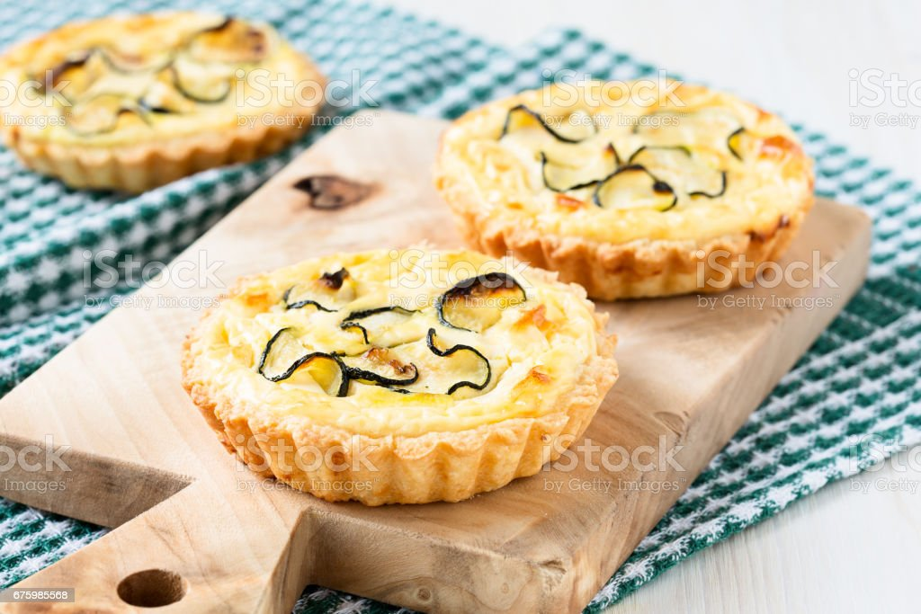 Tart with cheese and sliced small zucchini stock photo