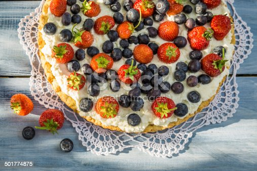 502634476 istock photo Tart with strawberries and blueberries 501774875