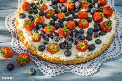 502634476 istock photo Tart with strawberries and blueberries 505468571