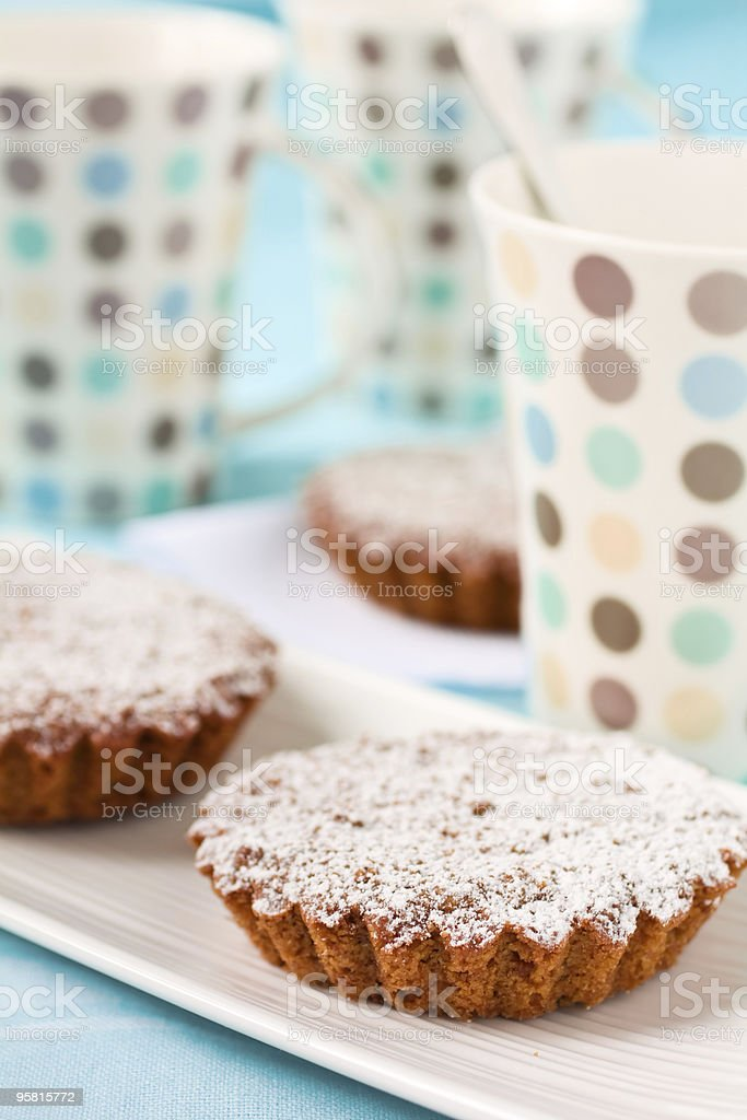 Tart with sugar and cups royalty-free stock photo