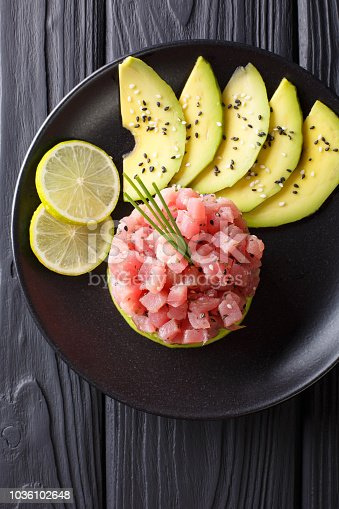 istock tartare of fresh raw tuna with spices close-up. Vertical top view 1036102648