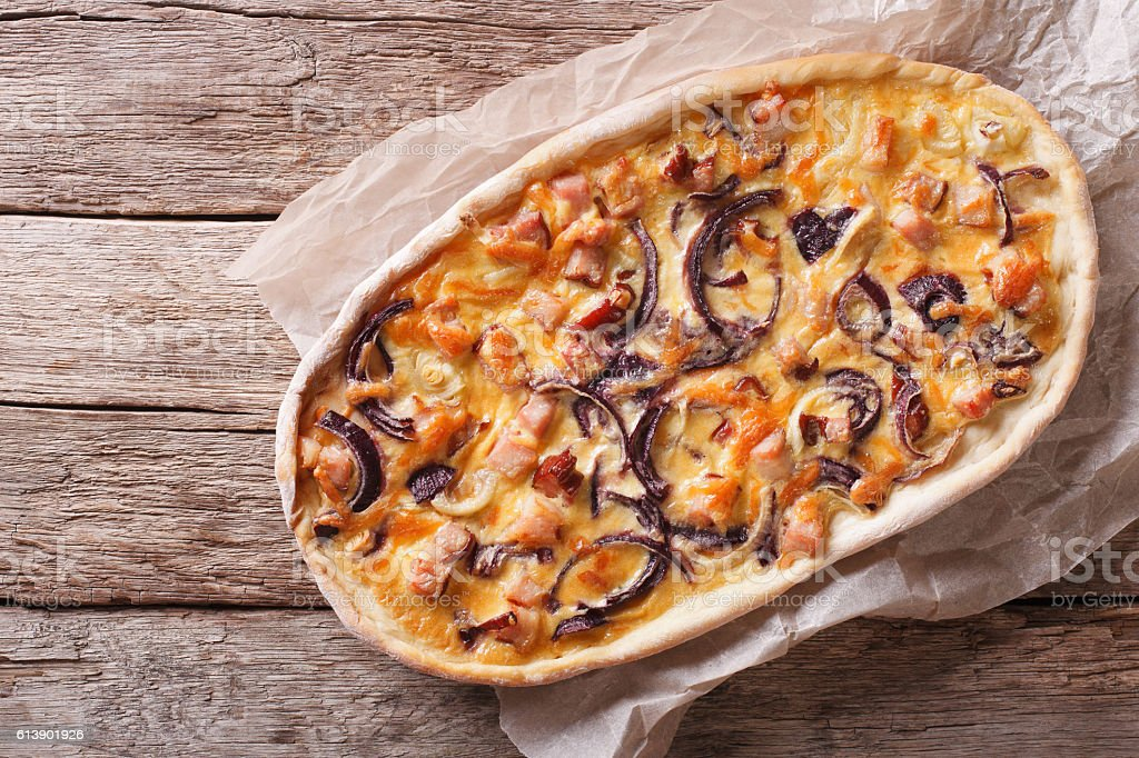 Tarte flambee on a paper. Horizontal top view stock photo