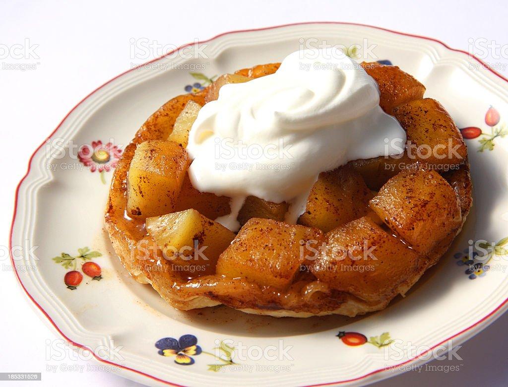 Tarte Tatin with whipped cream stock photo