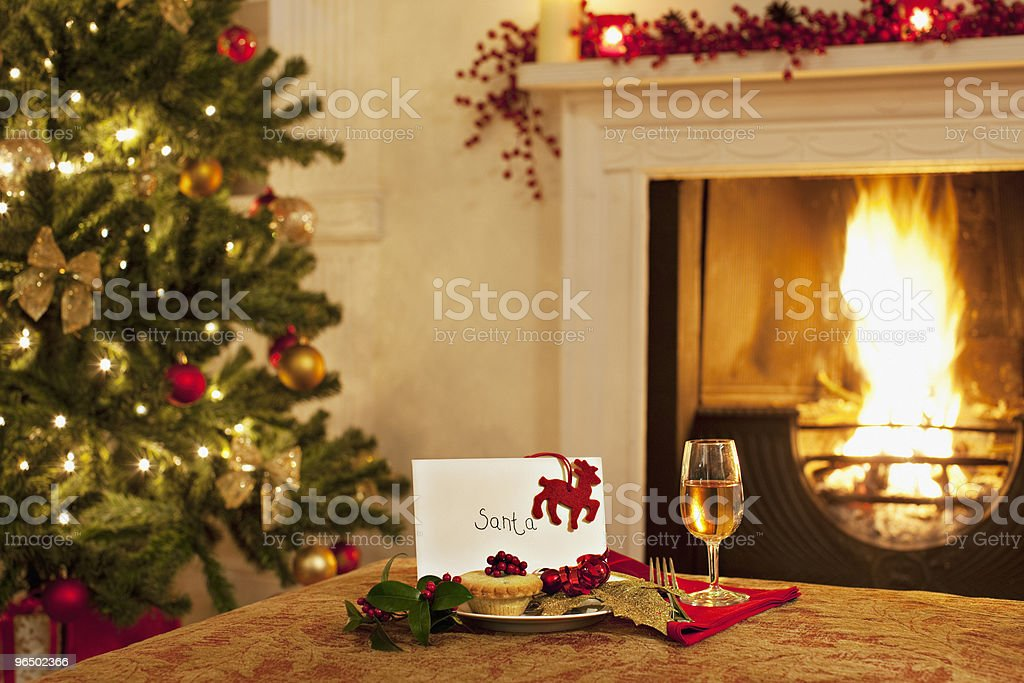 Tartlet, wine and card for Santa stock photo