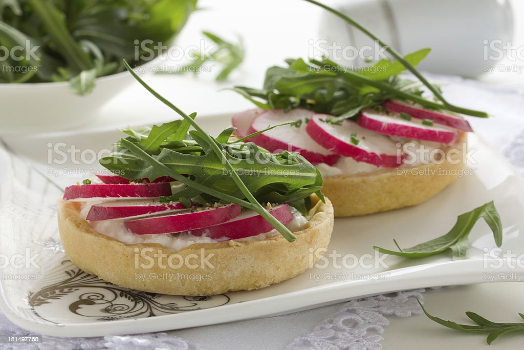 Tartlets salad with cheese and radish. royalty-free stock photo