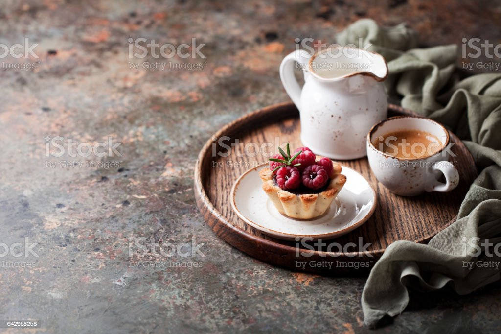 Tartlets with chocolate ganache and raspberries stock photo