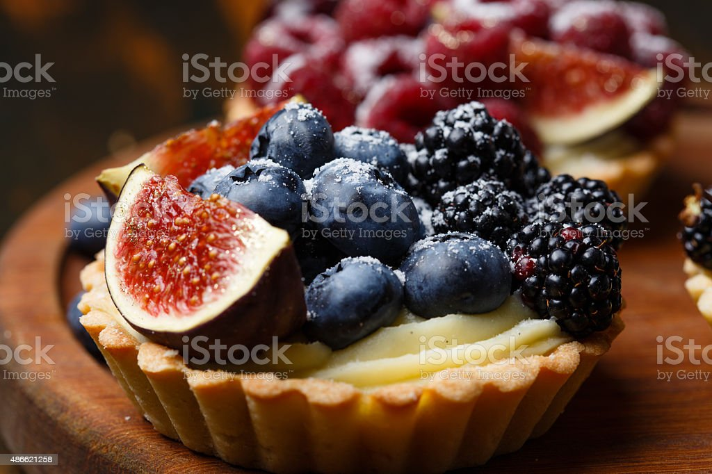 Tartlets with fresh berries stock photo