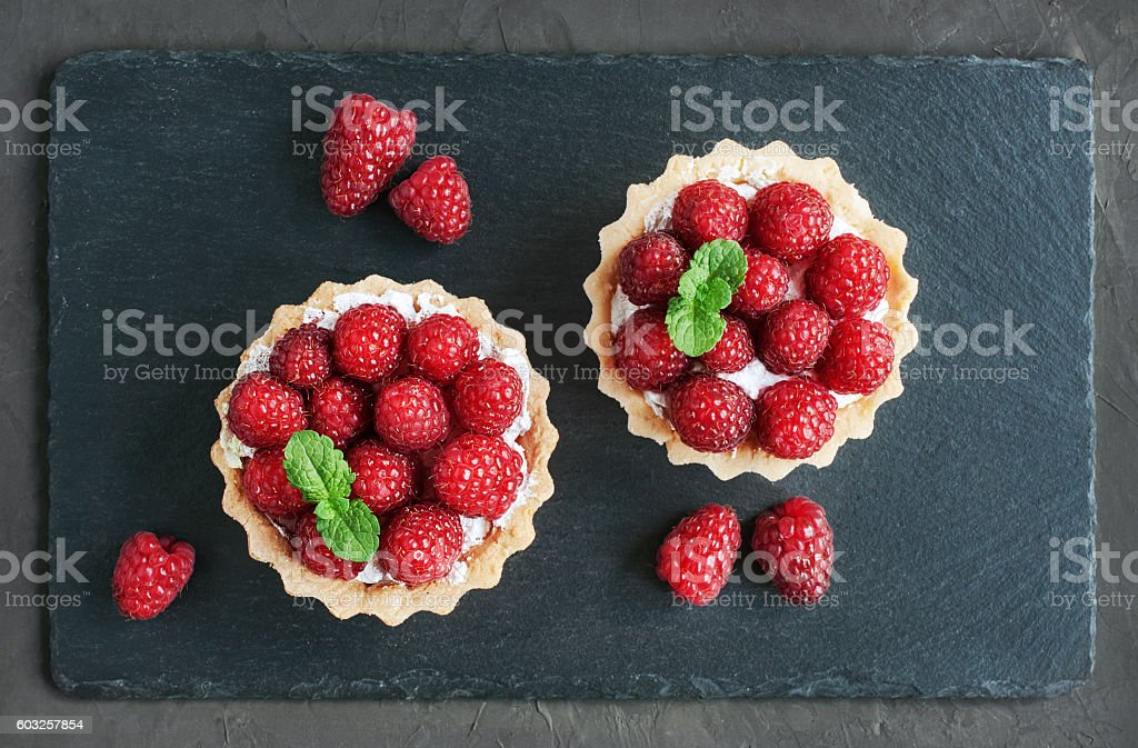 Tartlets with raspberries stock photo