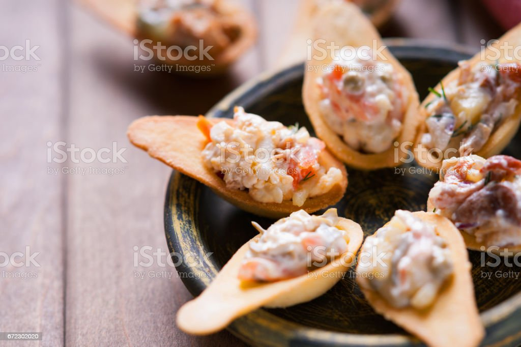 Tartlets with spicy salad on a wooden background stock photo