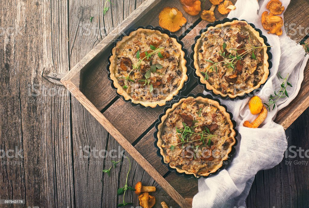 Tarts of puff pastry with mushrooms stock photo