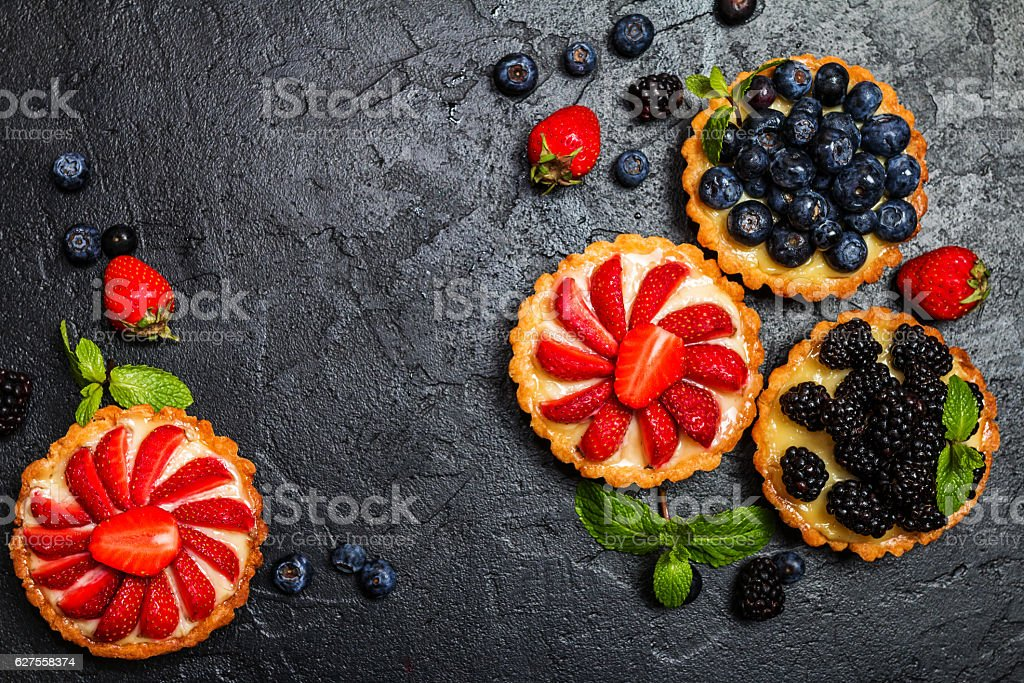 Tarts with lemon cream and fresh berries stock photo