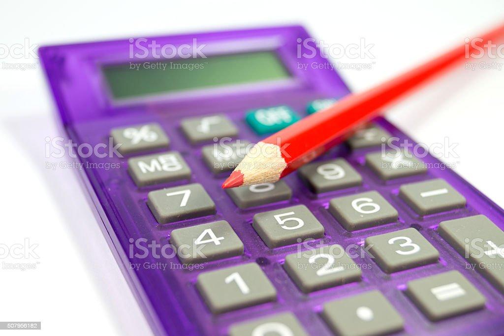 Taschenrechner und ein Stift stock photo