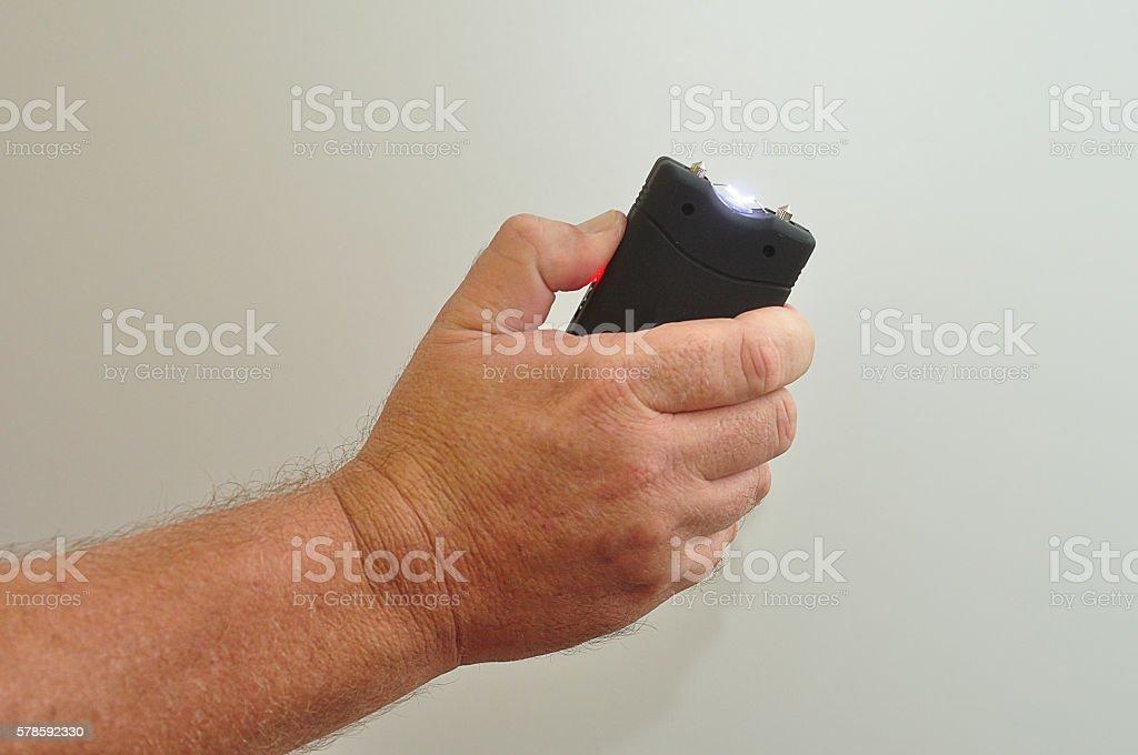 Taser in man's hand stock photo
