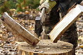istock Task of splitting campfire wood while hunting 876781242