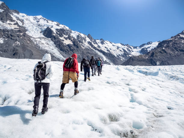 Tasman Glacier hiking in Mt Cook National Park of New Zealand. stock photo