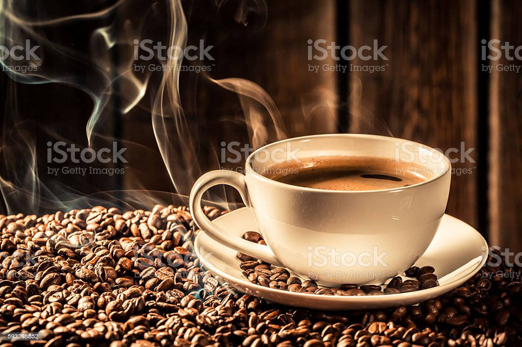 Taste coffee cup with roasted grains stock photo