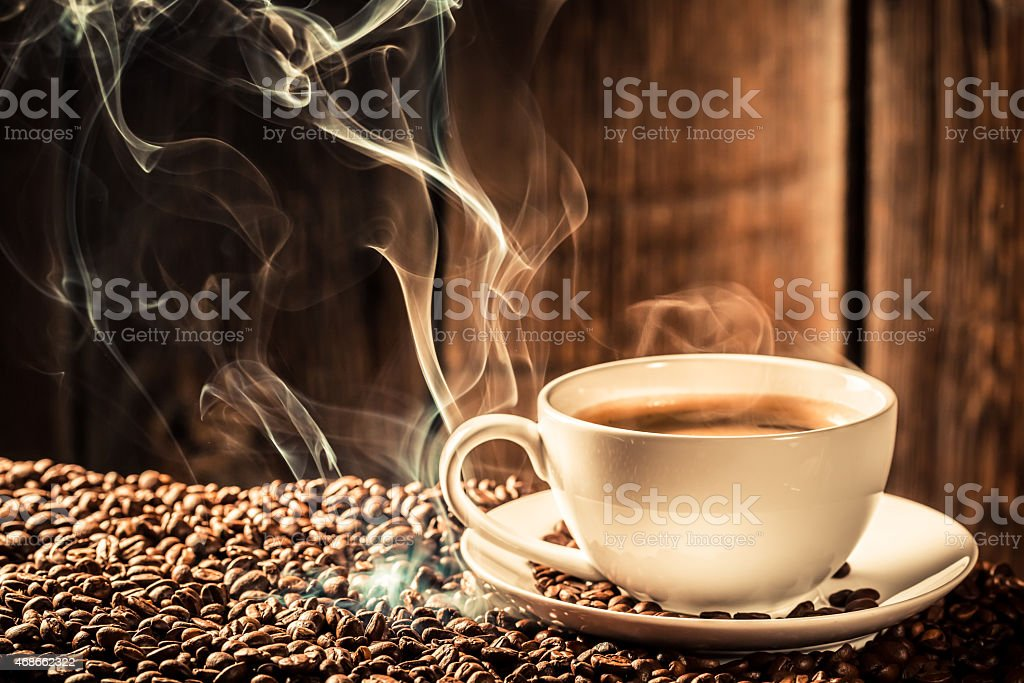 Taste cup of coffee with roasted grains stock photo