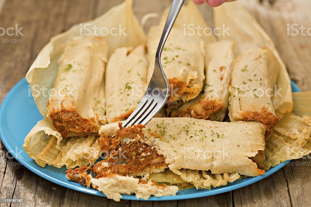 Tasting A Chicken Tamale stock photo
