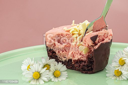 istock Tasting a raspberry mousse 1152703439