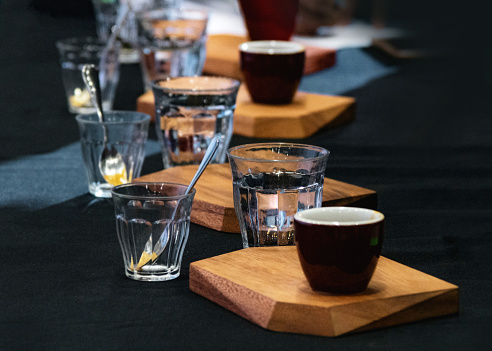 istock Tasting Coffee, Coffee tasting glasses in a coffee shop 1128807909