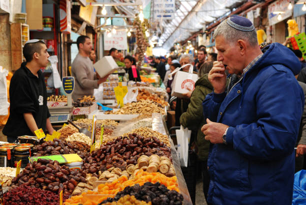 Tasting figs at the market. stock photo